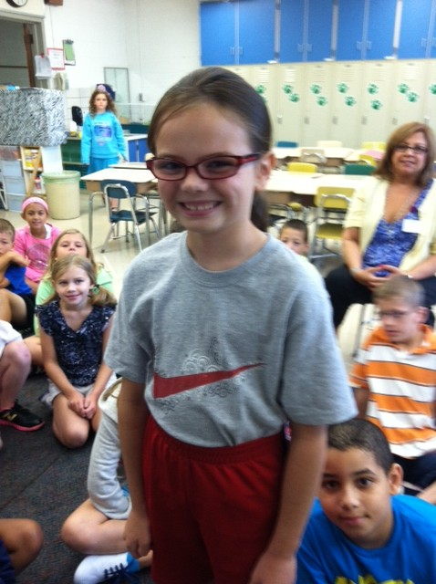 Ava is modeling a shirt that fits JUST RIGHT! Way to go , Ava!